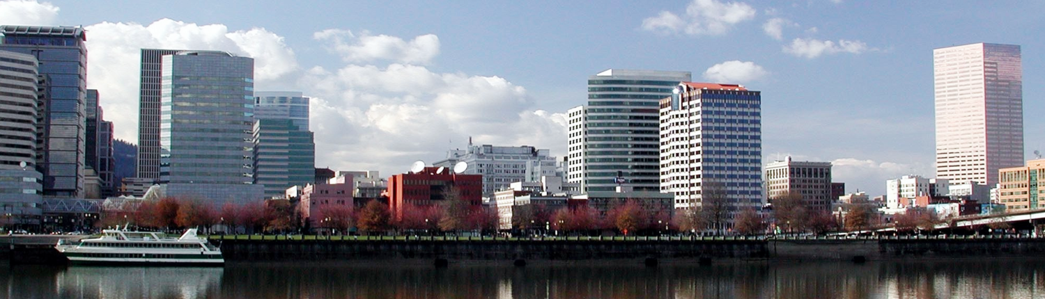Willamette River with one of the Portland Spirit Boats and the UsBank tower and down town Portland building on the background, Portland Lawyer car accidents