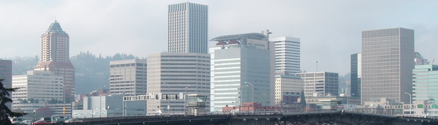 Portland Oregon skyline picture showing the burnside bridge the KOIN building, detention center and multiple building of down town Portland, Portland Lawyer, Accident Lawyer