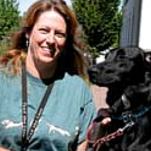 happy Woman with her black dog. Portland Lawyer Client testimonial, Accident lawyer, injury lawyer