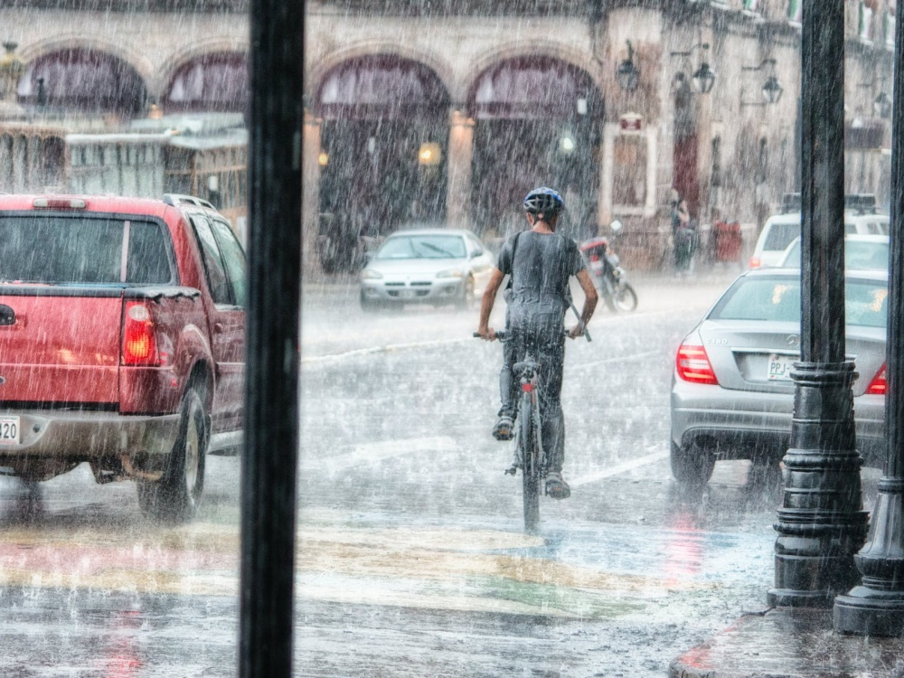 bicyclist riding under the rain . Motorcycle, Bicycle & Car Wrecks lawyer, accident lawyer portland